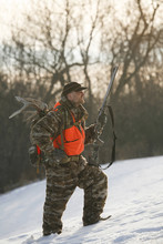 Hunter Walking Through Snow While Hunting For Whitetail Deer
