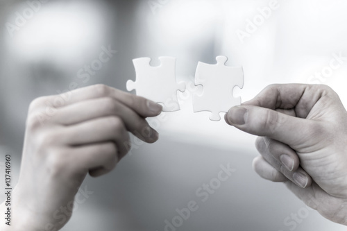 Fotografie, Obraz  man and woman hand holding jigsaw puzzles