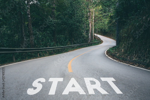 Photo  Startup to success business printed on road leading towards future concept