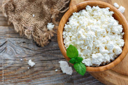 Poster Dairy products Homemade cottage cheese in bowl and leaves of mint.