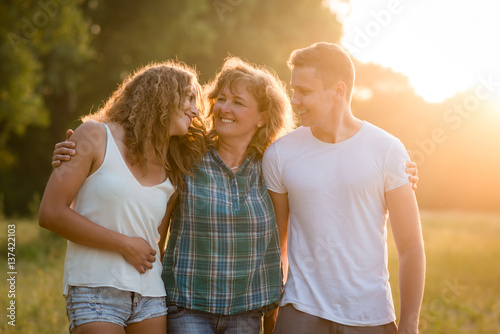 Caucasian family outdoors, spending quality time together.