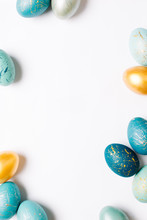 Frame Background With Gold And Blue Easter Eggs With Copy Space For Text