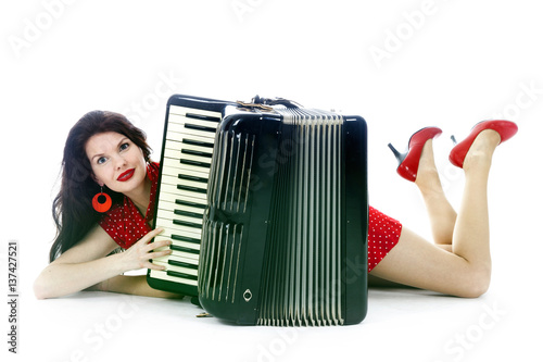 Pinturas sobre lienzo  pretty woman lies with accordion on floor of studio with white background