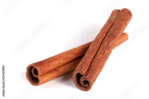 Fotografie, Obraz  two cinnamon sticks isolated on white background