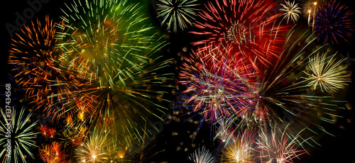 Colorful fireworks over dark sky Wallpaper Mural
