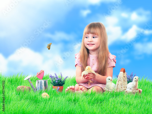Child on the green grass Canvas Print