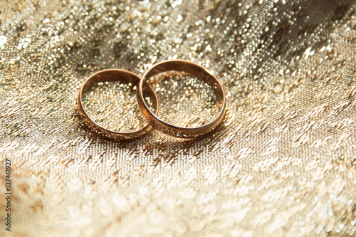 Gold Wedding Rings On A Gold Cloth Background Buy This Stock Photo