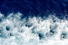 Blue Sea Waves With A Lot Of Sea Foam