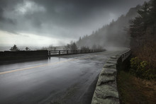Rain On A Wet Bridge Of North Carolina?s Linn Cove Viaduct On The Blue Ridge Parkway With Moody, Low-hanging Storm Clouds And Mist; North Carolina, United States Of America