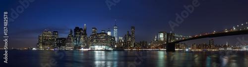 New York city panorama skyline with Brooklyn Bridge at night