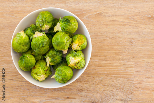 Papiers peints Bruxelles Bowl of Brussels Sprouts with copy space provided.