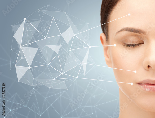 Fotografie, Obraz  beautiful woman half face with low poly projection