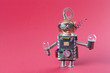 canvas print picture - Robot concept retro style. Circuits socket chip toy mechanism, funny head, eyes glasses, light bulbs in hands. Copy space, pink background