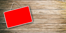 Red Sign Hanging On Wooden Background