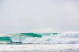 Blue waves in tropical ocean - 137517563