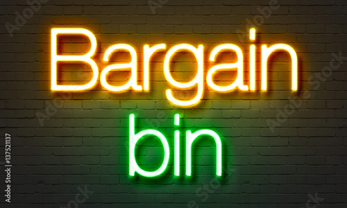 Bargain bin neon sign on brick wall background. Canvas Print
