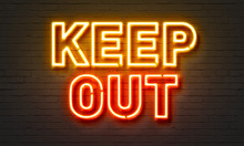 Keep Out Neon Sign On Brick Wa...
