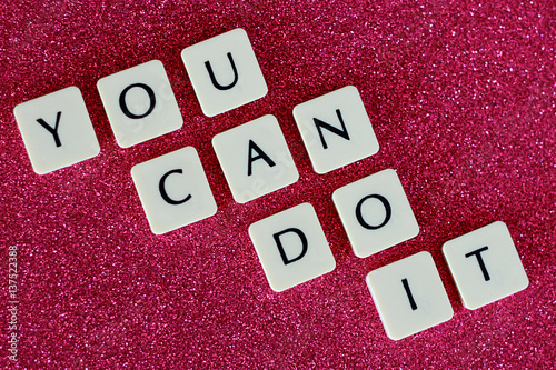 Valokuva  You Can Do It Letters On Pink Glitter Background