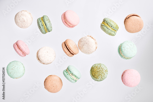 Poster Macarons Macarons cake, top view flat lay, handmade pattern on pink background