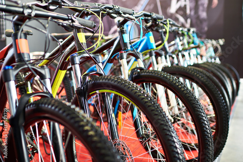 Modern mountain bikes in sports shop