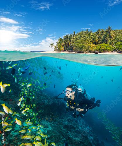Woman scuba diver exploring sea bottom