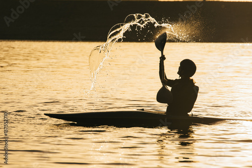 Valokuvatapetti Female rower shifts water overhead in joy after hard training session