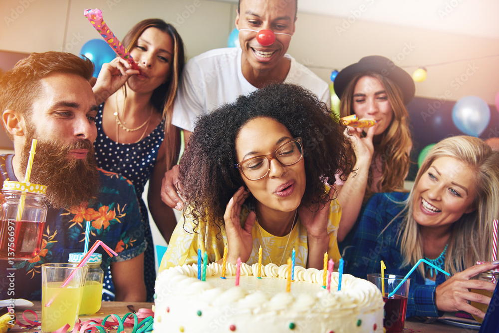 Fototapety, obrazy: Happy woman blowing candles on cake
