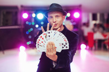 Magician Showing Trick With Pl...