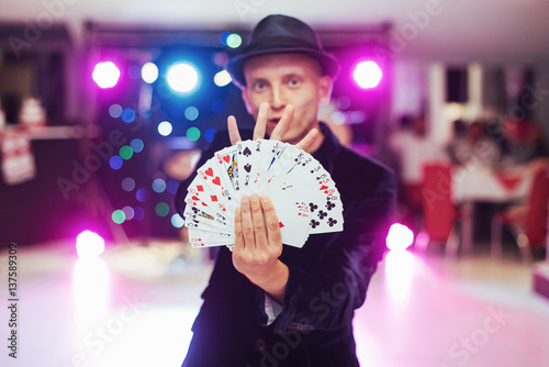 Magician showing trick with playing cards. Magic, circus Poster