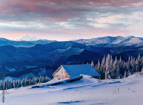 Fototapety, obrazy: Fantastic sunset over snow-capped mountains and wooden chalets