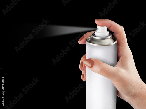 Láminas  White spray can isolated on black background on woman hand, Aerosol Spray Can, M