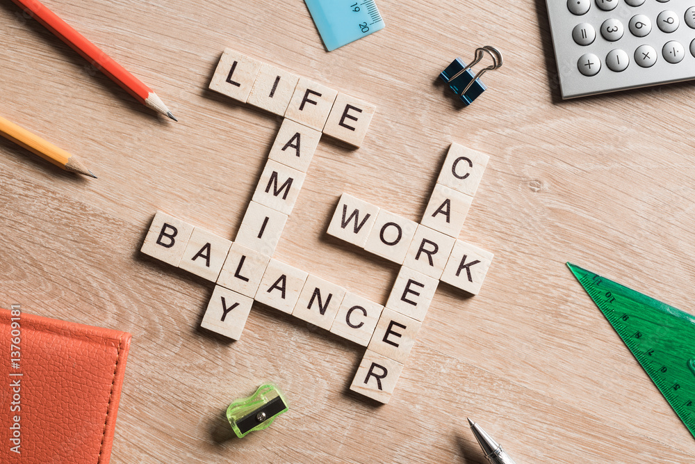 Fototapeta Words work life balance and family on table collected with wooden cubes