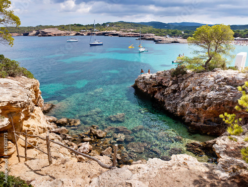 Beautiful secret lagoon at Ibiza. Luxury rest at Balearic Islands. Beautiful place for diving. Nature of the Mediterranean.