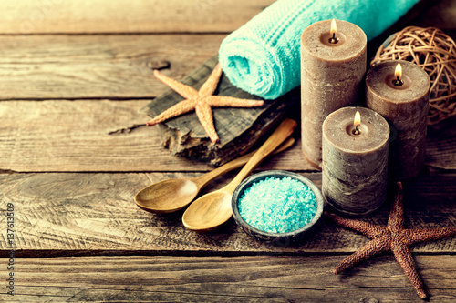 Set for spa treatments with cosmetic products for body care and relaxation on wooden background with space for a text