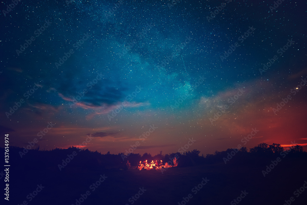 Fototapety, obrazy: Camping fire under the amazing blue starry sky with a lot of shining stars and clouds. Travel recreational outdoor activity concept.