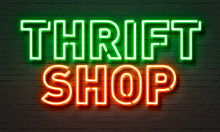 Thrift Shop Neon Sign On Brick Wall Background.