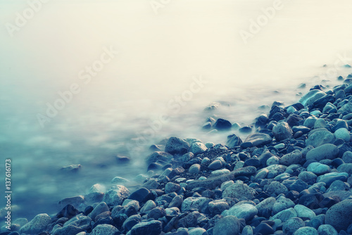 Dreamy natural background with sea shore, rocks and waves Poster