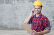 builder with smartphone, construction
