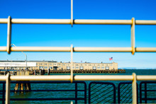 Ferry Building Behind A Cage W...