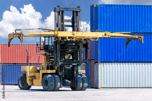 Forklift handling container box loading at the Docks with Truck Wallpaper Mural