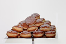 Heap Of Sweet Bavarian Cream Filled Donuts On Tray