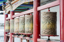 Tibetan Prayer Wheels At The Famous Kumbum Monastery In Qinghai Province, China