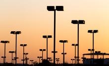 Light Poles At Sunset