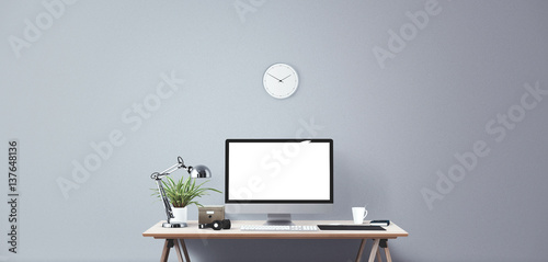 Computer display and office tools on desk Canvas Print