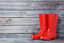 Red Rubber Boots On A Grey Woo...