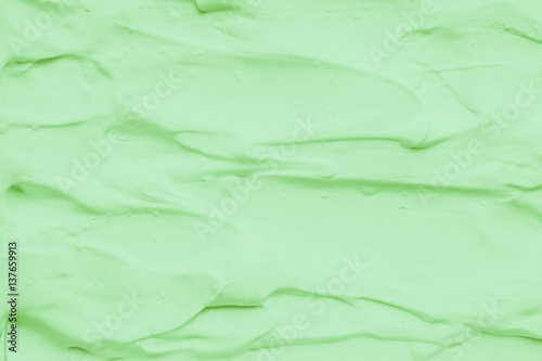Photo Stands Abstract wave mask clay scrub for face and body. Texture, Selective focus.