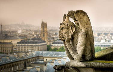 Chimera (gargoyle) of the Cathedral of Notre Dame de Paris overlooking Paris, France