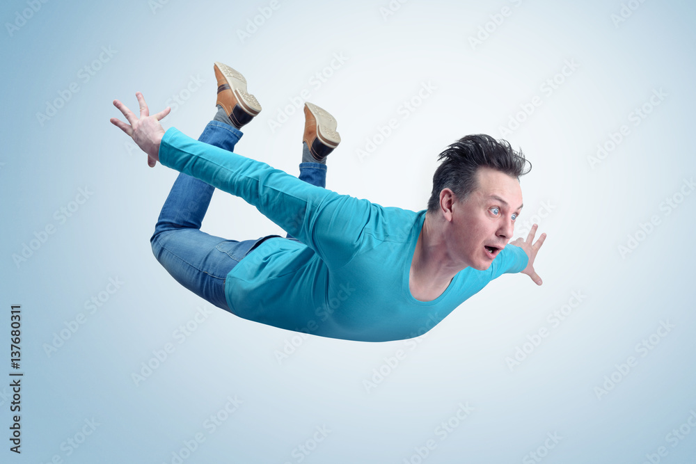 Fototapety, obrazy: Crazy man in shirt and jeans is flying in the sky. Jumper concept