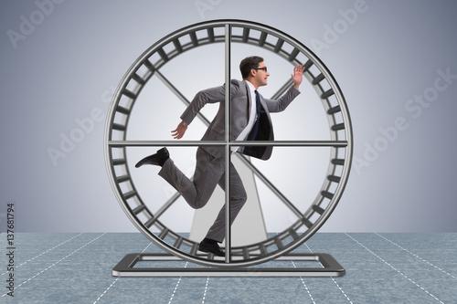 Fotografía Businessman running on hamster wheel