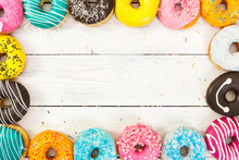Colorful Donuts On Light Woode...